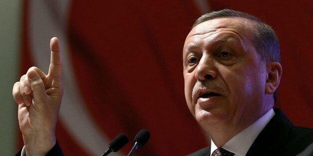 Turkey's President Recep Tayyip Erdogan addresses women during a meeting in Ankara, Turkey, Friday, March...