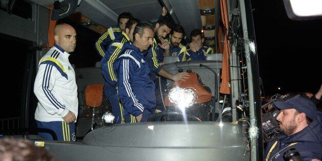 TRABZON, TURKEY - APRIL 04: Turkish soccer team Fenerbahce's team bus, damaged with foreign objects by...