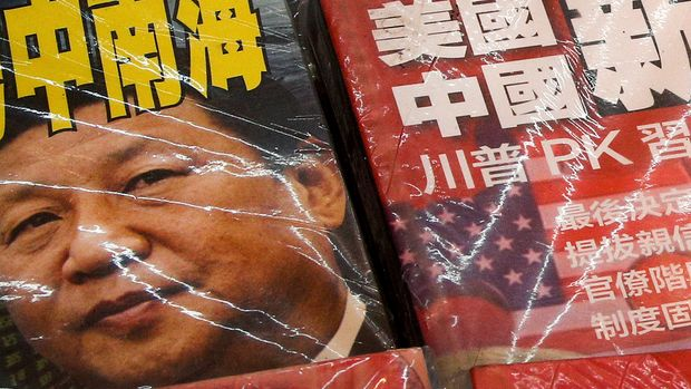 In this July 4, 2019, photo, magazines with front covers featuring Chinese President Xi Jinping with South China Sea and Xi against U.S. President Donald Trump are placed on sale at a roadside bookstand in Hong Kong. The United States said it's concerned by reports of China's interference with oil and gas activities in the disputed waters of the South China Sea, where Vietnam accuses Beijing of violating its sovereignty. (AP Photo/Andy Wong)