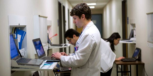 Gregory Shumer, center, Omer Shah, left, and Jasmine Zheng, all third-year Georgetown medical students,...