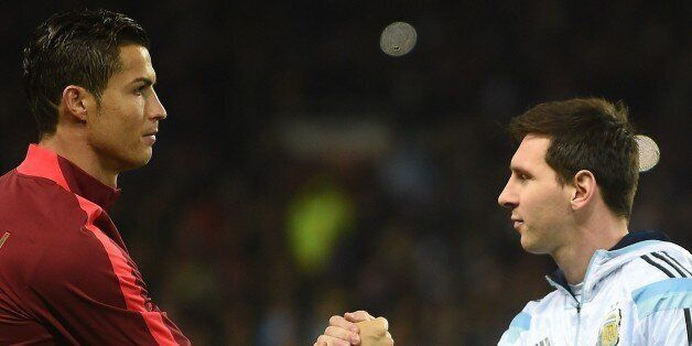 Argentina striker Lionel Messi (R) shakes hands with Portugal's striker Cristiano Ronaldo (L) ahead of...