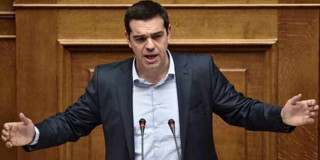 Greek Prime Minister Alexis Tsipras addresses a parliament session in Athens on March 30, 2015. The EU...