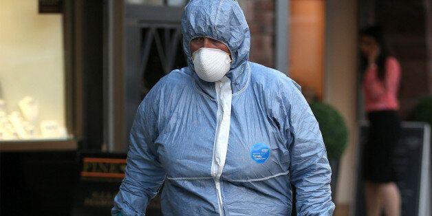 LONDON, ENGLAND - APRIL 07: A police forensics officer enters a Hatton Garden safe deposit centre on...