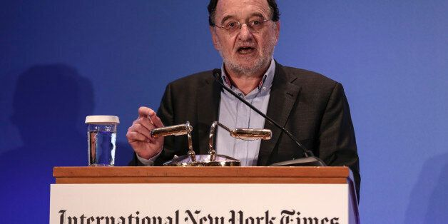 Greece's energy and environment minister Panagiotis Lafazanis addresses the audience during an energy...