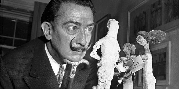 ** FILE ** Resting his chin on the handle of his cane, Spanish surrealist painter Salvador Dali studies...