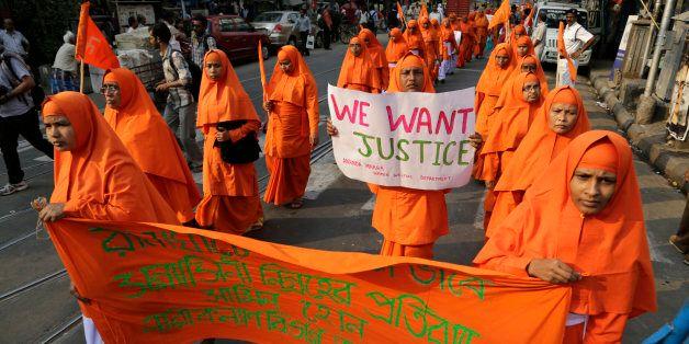 Nuns of Ananda Marga, a spiritual and social service organization, walk in a silent procession protesting...
