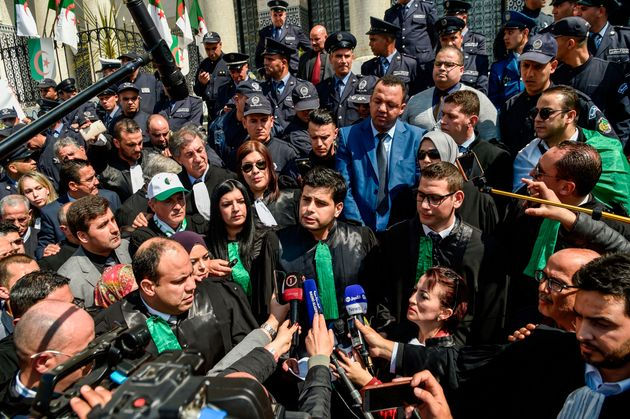 Algerian lawyers and judges speak to the press as they gather for a demonstration for the independence...