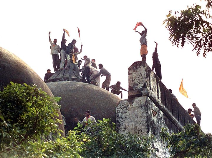 Kar sevaks on top of the Babri Masjid on 6 December 1992, hours before the mosque was demolished.