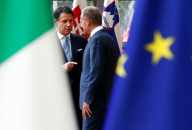 Italian Prime Minister Giuseppe Conte speaks with European Union Council President Donald Tusk in Brussels,...