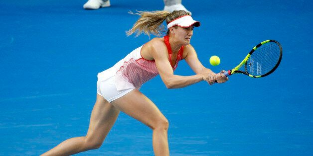 Eugenie Bouchard of Canada makes a backhand return to Agnieszka Radwanska of Poland during their second round match at the Australian Open tennis championships in Melbourne, Australia, Wednesday, Jan. 20, 2016.(AP Photo/Vincent Thian)