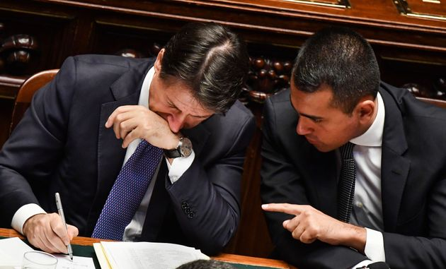 Italy's Foreign Minister Luigi Di Maio (R) speaks to Italy's Prime Minister Giuseppe Conte on September...