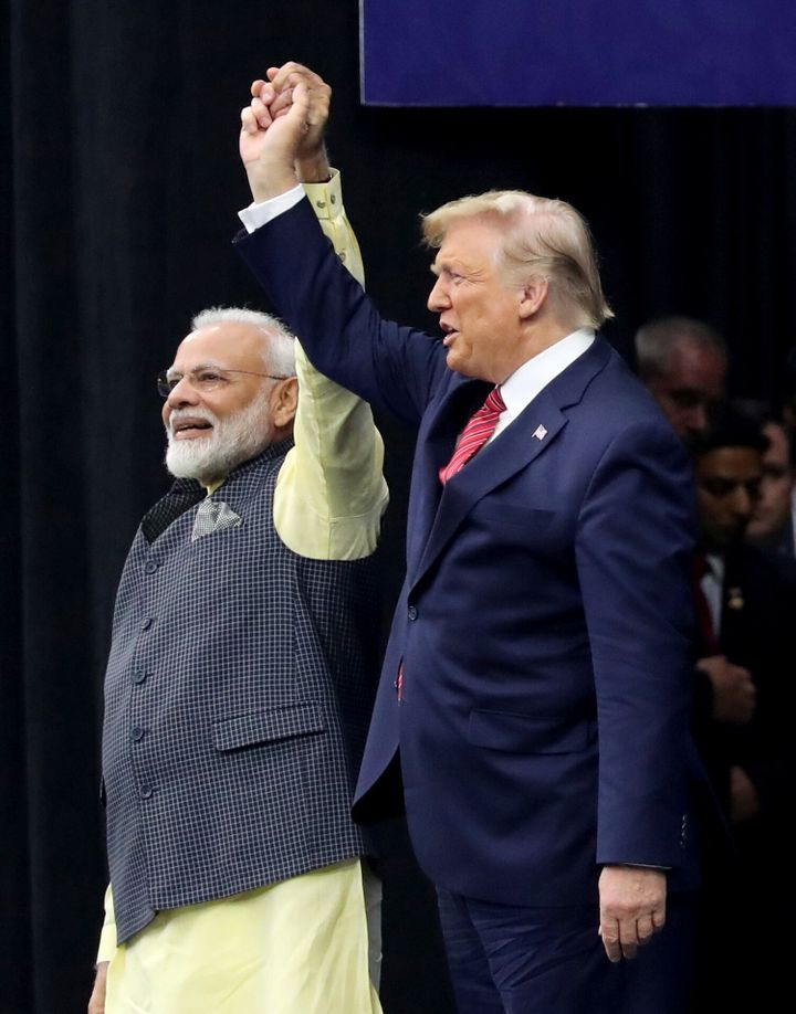 "Trump, who called the gathering a ""profoundly historic event,"" was greeted with a standing ovation by the Indian-"