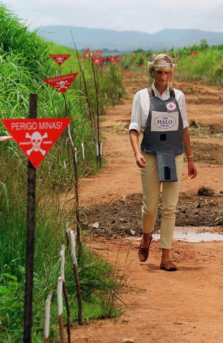 Princess Diana touring a minefield in body armour during her visit to Angola in 1997.