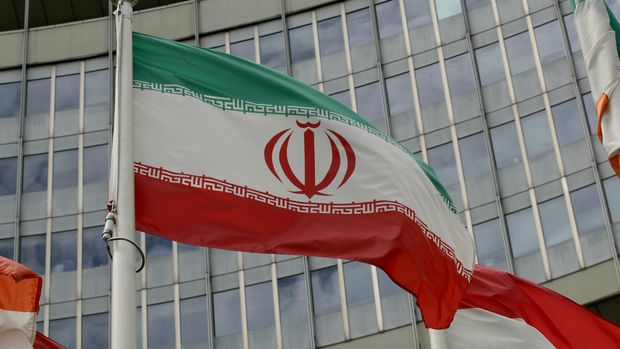"The Iranian flag waves outside of the UN building that hosts the International Atomic Energy Agency, IAEA, office inside in Vienna, Austria, Wednesday, July 10, 2019. President Donald Trump's ""maximum pressure"" campaign against Iran is at a crossroads. His administration is trying to decide whether to risk stoking international tensions even more by ending one of the last remaining components of the 2015 nuclear deal.  (AP Photo/Ronald Zak)"