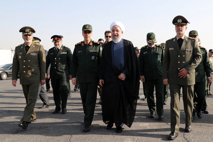 President Hassan Rouhani (center) arrives for a military parade ceremonymarking the 39th anniversary of outset of Iran-Iraq war.