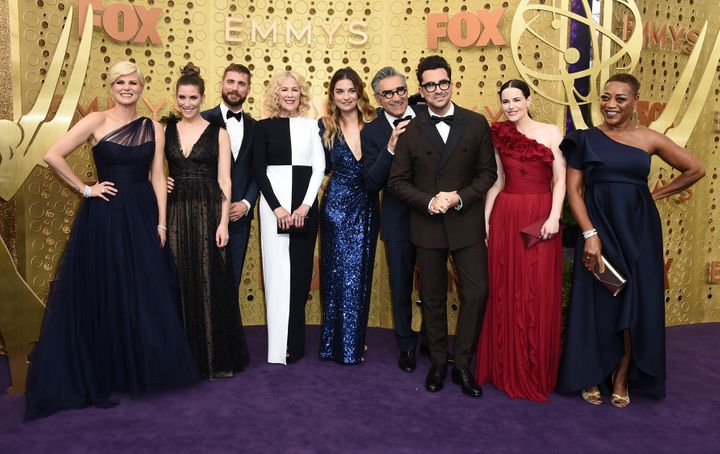 "The ""Schitt's Creek"" cast, from left: Jennifer Robertson, Sarah Levy, Dustin Milligan, Catherine O'Hara, Annie Murphy, Eugene Levy, Daniel Levy, Emily Hampshire, Karen Robinson, at the Emmy Awards on Sunday, Sept. 22, 2019."