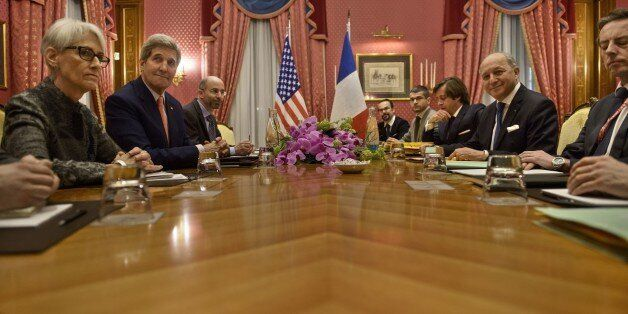 US Secretary of State John Kerry (2nd L) and French Foreign Minister Laurent Fabius (2nd R) wait for...