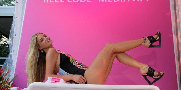 MIAMI BEACH, FL - JULY 21: Danielle Knudson models for Reel Code At Mercedes-Benz Fashion Week Swim 2014...