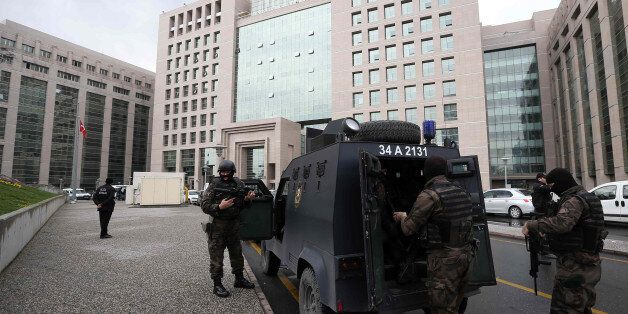 Members of special security forces stand outside the main courthouse in Istanbul, Turkey, Tuesday, March...