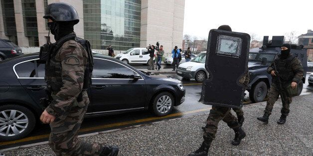 Members of special security forces move toward the main courthouse in Istanbul, Turkey, Tuesday, March...
