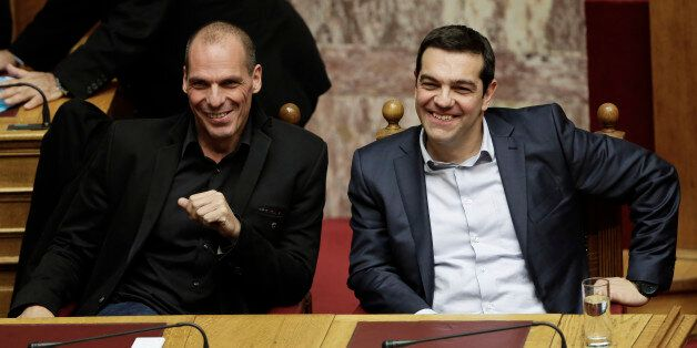 Greece's Prime Minister Alexis Tsipras and Greece's Finance Minister Yanis Varoufakis smile during a...