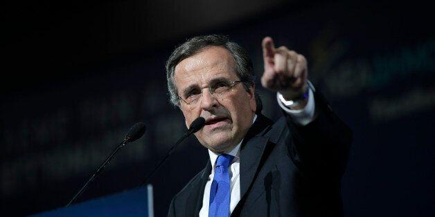 Greece's Prime Minister Antonis Samaras delivers his pre-election speech at the Taekwondo Indoor Stadium...