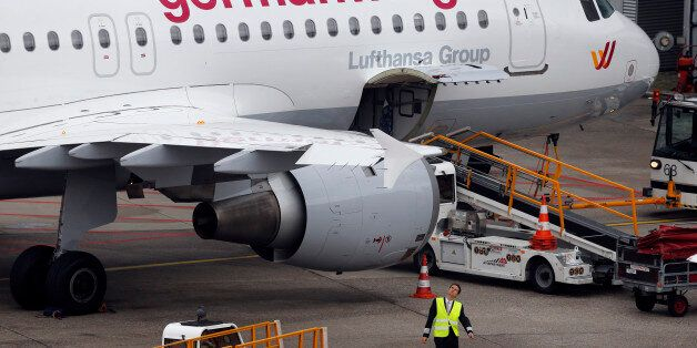FILE - In this Oct. 16, 2014 file photo an Airbus 320 of Germanwings is parked at the airport as their...