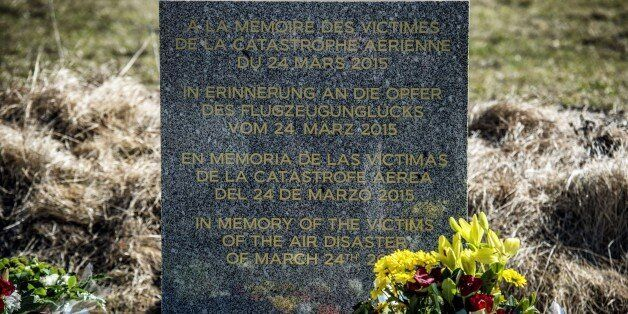 A stele, carved in French, German, Spanish and English, in memory of the victims of the Germanwings Airbus...