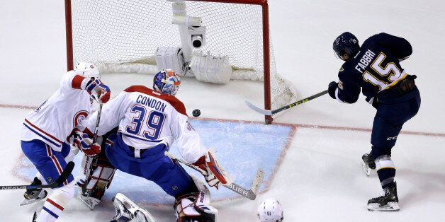St. Louis Blues' Robby Fabbri, right, scores past Montreal Canadiens goalie Mike Condon (39) and Alexei...