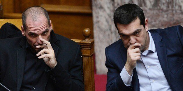 Greek Prime Minister Alexis Tsipras (R) sits along side Finance Minister Yianis Varoufakis during the...