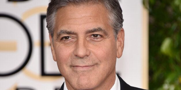 George Clooney wears a buttong reading