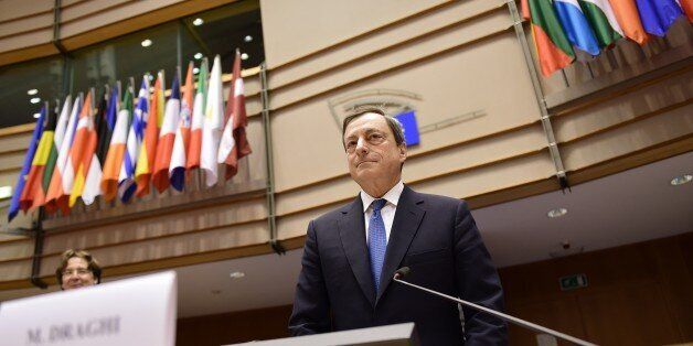 European Central Bank President Mario Draghi arrives to deliver introductory remarks in front of the...