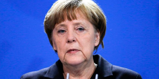 German Chancellor Angela Merkel delivers a statement in Berlin, Thursday, March 26, 2015 after first...