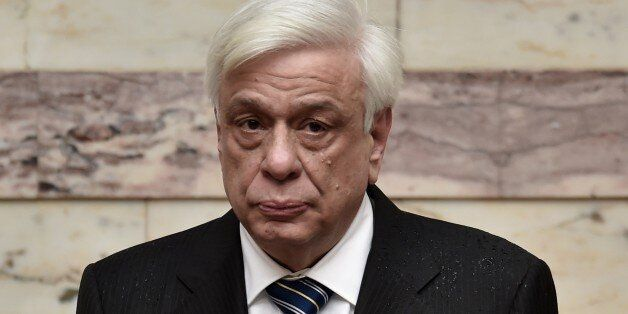 New Greek President Prokopis Pavlopoulos (L) looks on during his swearing in ceremony in parliament in...