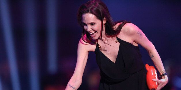 """Angelina Jolie accepts the award for favorite villain for """"Maleficent"""" at Nickelodeon's 28th annual..."""