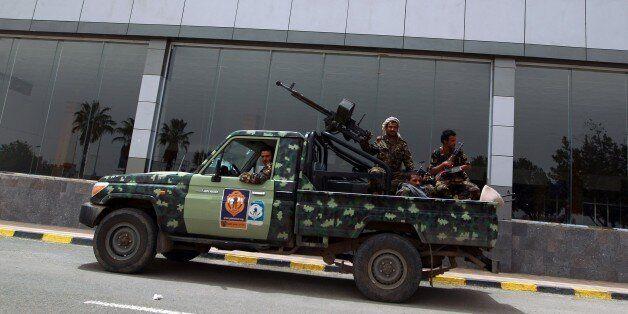 Armed member of Shiite Huthi militia, wearing military fatigue, patrol the Sanaa International Airport...