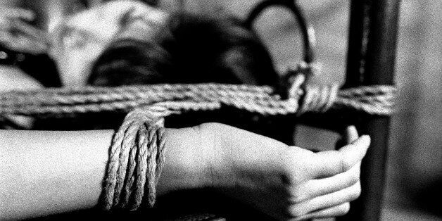TOKYO, JAPAN - 1998/10/01: Mizuho Tohno, a nineteen-year-old porn actress, bound and tied to a bed during...