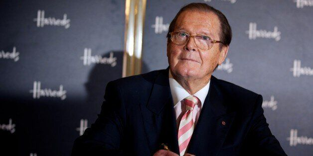British Actor Roger Moore poses for photographs as he signs books at the launch of his book Bond on Bond,...