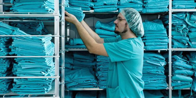 Stacking shelves with scrubs in hospital
