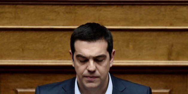 Greek Prime Minister Alexis Tsipras attends a parliament session in Athens on March 30, 2015. The EU...