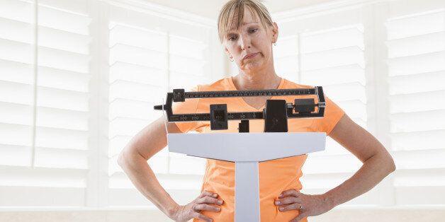 Caucasian woman weighing