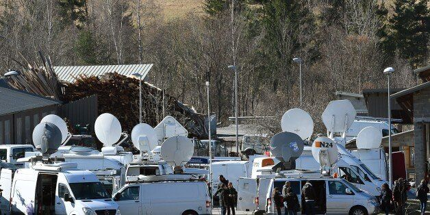 Journalists wait on March 26, 2015 on an air base in Seyne-les-Alpes, French Alps two days after a Germanwings...