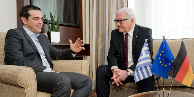 German Foreign Minister Frank-Walter Steinmeier, right, meets with Greek Prime Minister Alexis Tsipras...