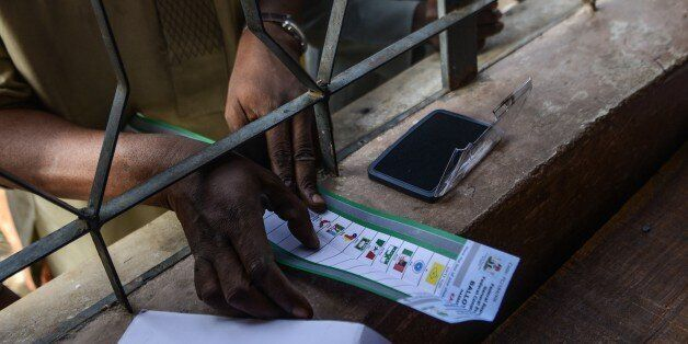 KANO, NIGERIA - MARCH 28: A Nigerian man gives finger prints to register at Daawa polling station in...