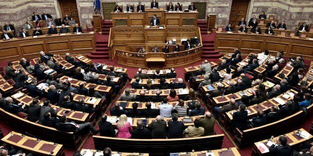Greek Prime Minister Alexis Tsipras (C) addresses a parliament session in Athens on March 30, 2015. The...