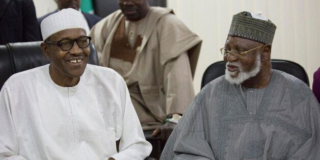 Nigerian former Gen. Muhammadu Buhari, left, and former Nigeria President Abdulsalami Abubakar, right,...