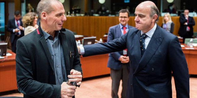 Spanish Economy Minister Luis de Guindos, right, greets Greek Finance Minister Yanis Varoufakis during...