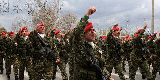 Greek army paratroopers march during a parade to commemorate Independence Day at the northern Greek city...
