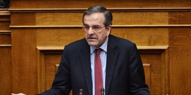 Greece main opposition party leader, Antonis Samaras speaks during a parliament session ahead of the...