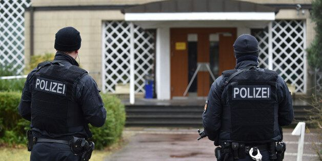 Police guard the entrance of a synagogue in Bremen, Germany, Sunday March 1, 2015. Police in the German...